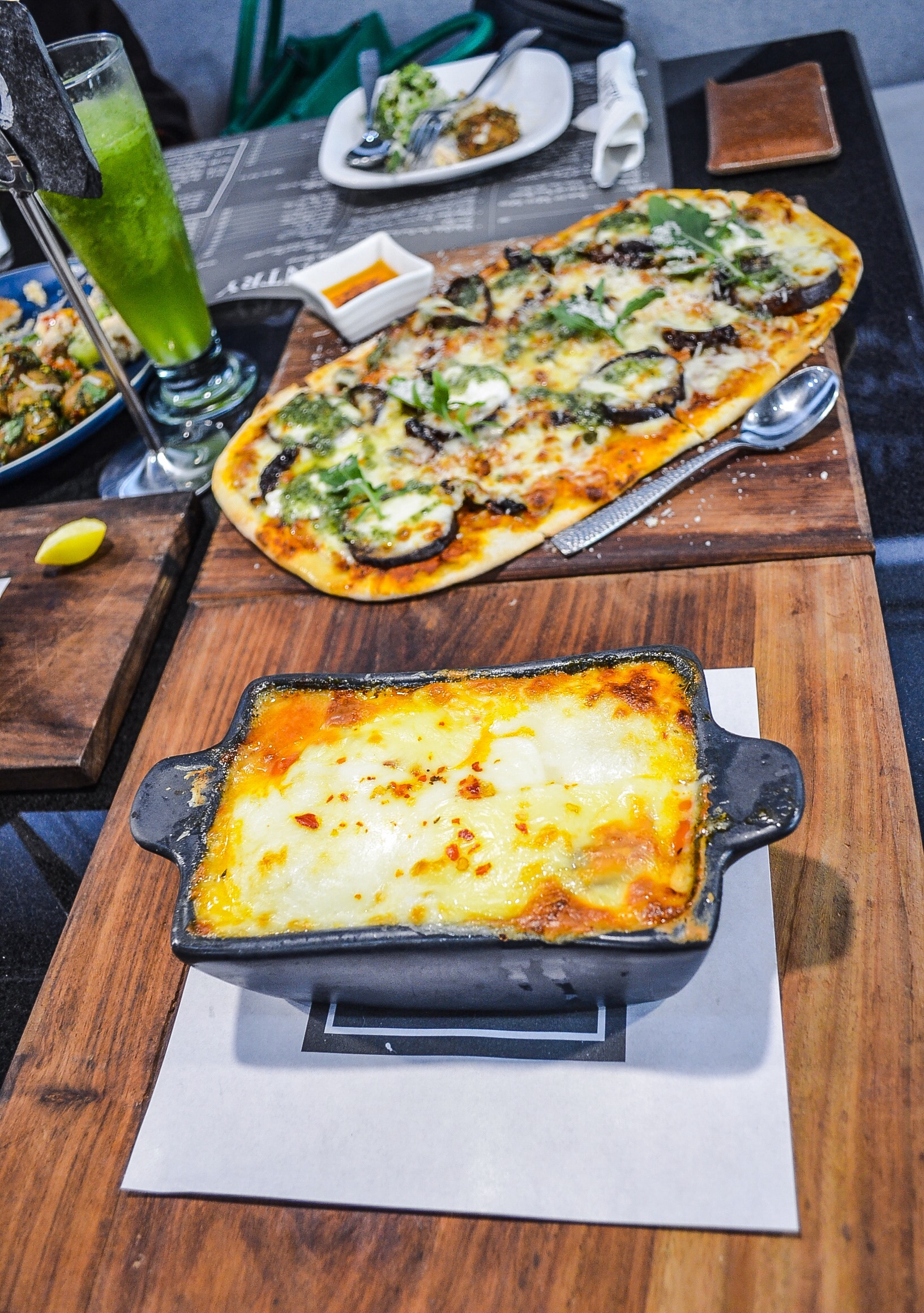 Comforting Carbs: Pizza Caponata and House Special Lasagna at The Pantry by The Polo Lounge (Emporium Mall).
